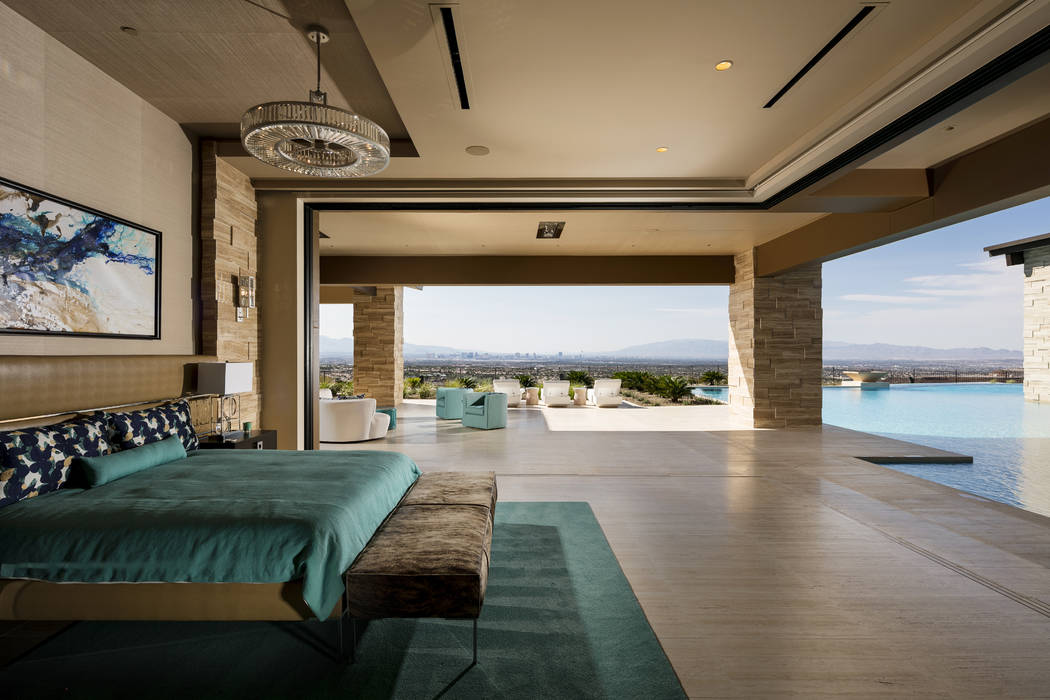 The master bedroom opens to the pool in this $15.5 million Ascaya mansion. (Shay Velich)