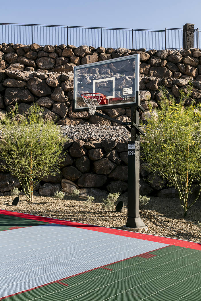 A half-size basketball court is outside. (Sun West Custom Homes)