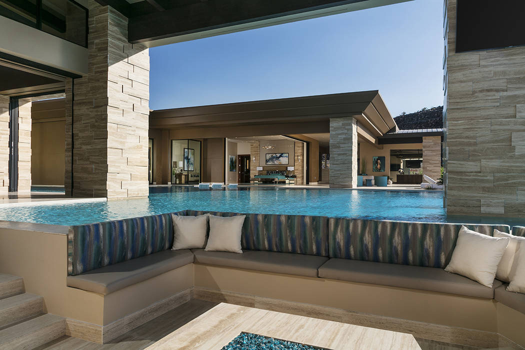 There is a sunken seating area in the middle of the pool. (Sun West Custom Homes)