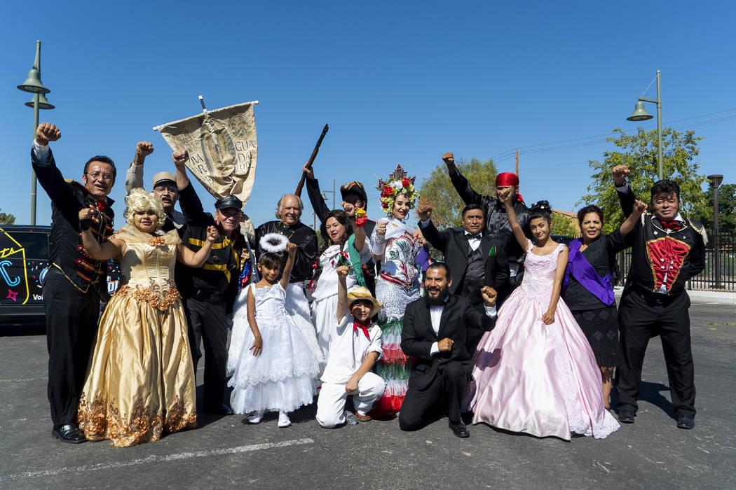 """The cast of """"La Independenca de Mexico""""ʰose for a photograph before the El Tiempo Fiesta Las Vegas parade kicks off at Craig Ranch Regional Park in North Las Vegas, Saturday, Sept. 15, 2018.(Marc ..."""