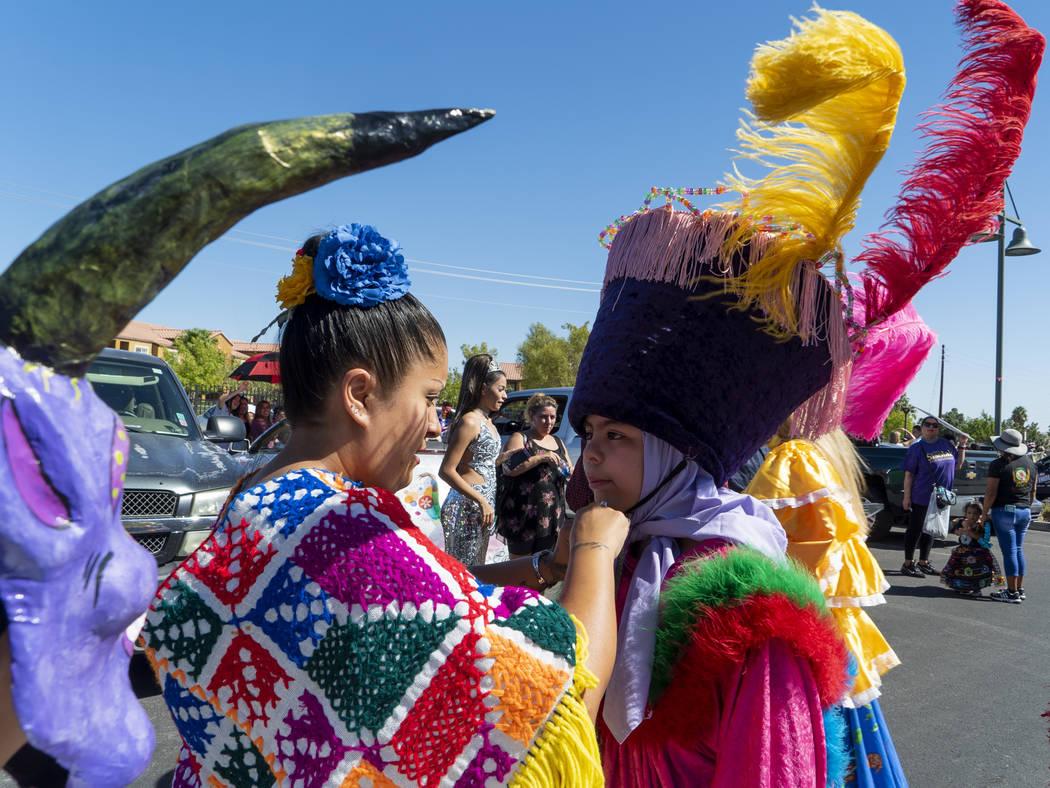 Raelynn Allgood helps Leandro Aragon, 12, put on his outfit for the El Tiempo Fiesta parade Las Vegas at Craig Ranch Regional Park in Las Vegas, Saturday, Sept. 15, 2018.(Marcus Villagran/Las Vega ...