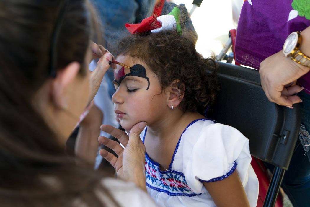 Camila Oliva, 2, gets her face painted at the El Tiempo Fiesta Las Vegas at Craig Ranch Regional Park in North Las Vegas, Saturday, Sept. 15, 2018.(Marcus Villagran/Las Vegas Review-Journal) @marc ...