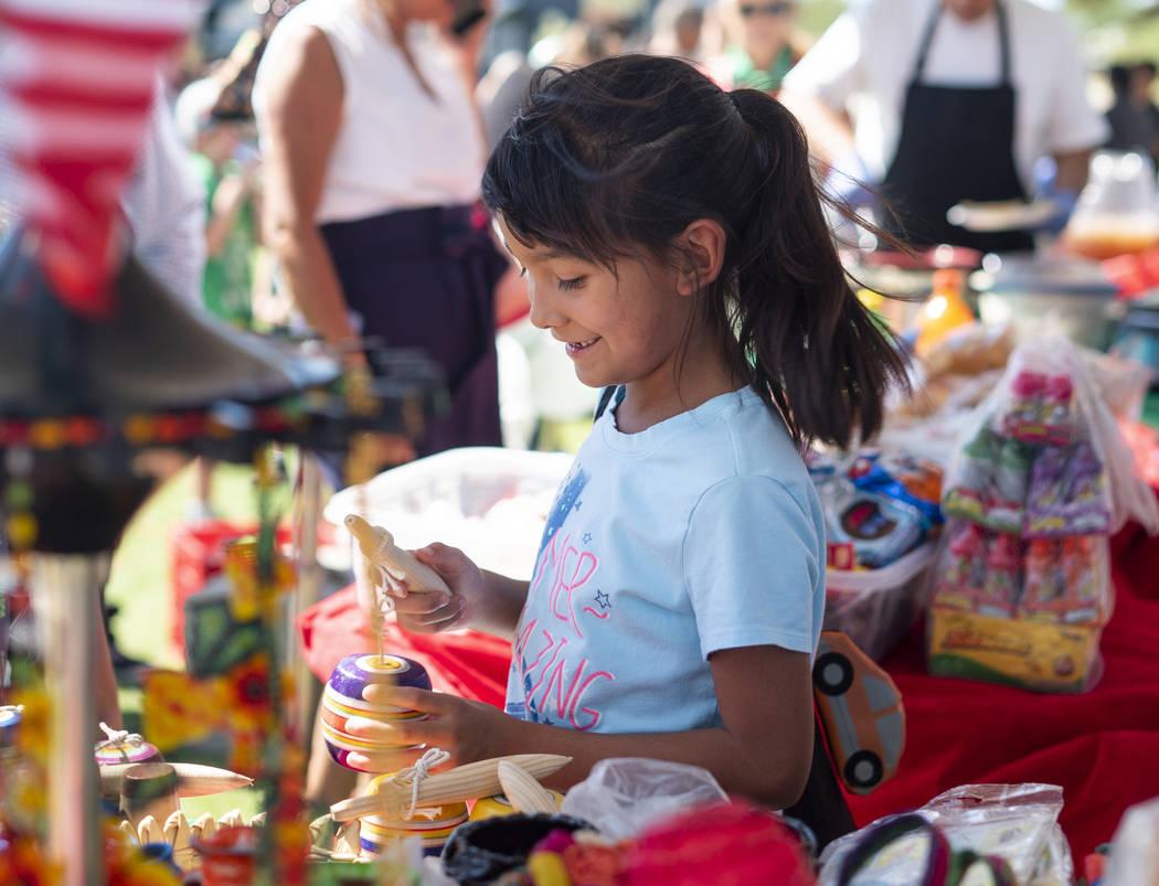 Alanna Hernandez, 7, plays with a Mexican balero at the El Tiempo Fiesta Las Vegas at Craig Ranch Regional Park in North Las Vegas, Saturday, Sept. 15, 2018.(Marcus Villagran/Las Vegas Review-Jour ...
