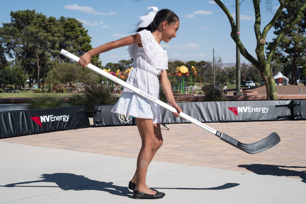 Armani Sierra, 7, learns how to play hockey at the Vegas Golden Knights booth at the El Tiempo Fiesta Las Vegas at Craig Ranch Regional Park in North Las Vegas, Saturday, Sept. 15, 2018.(Marcus Vi ...
