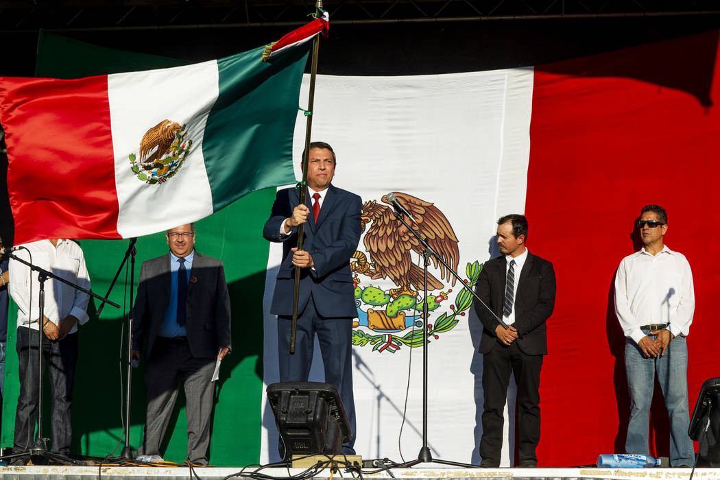 "Alejandro Madrigal, consul general of Mexico, holds the Mexican flag during the ""El Grito de Independence of Mexico"" at the El Tiempo Fiesta Las Vegas at Craig Ranch Regional Park in North Las Veg ..."