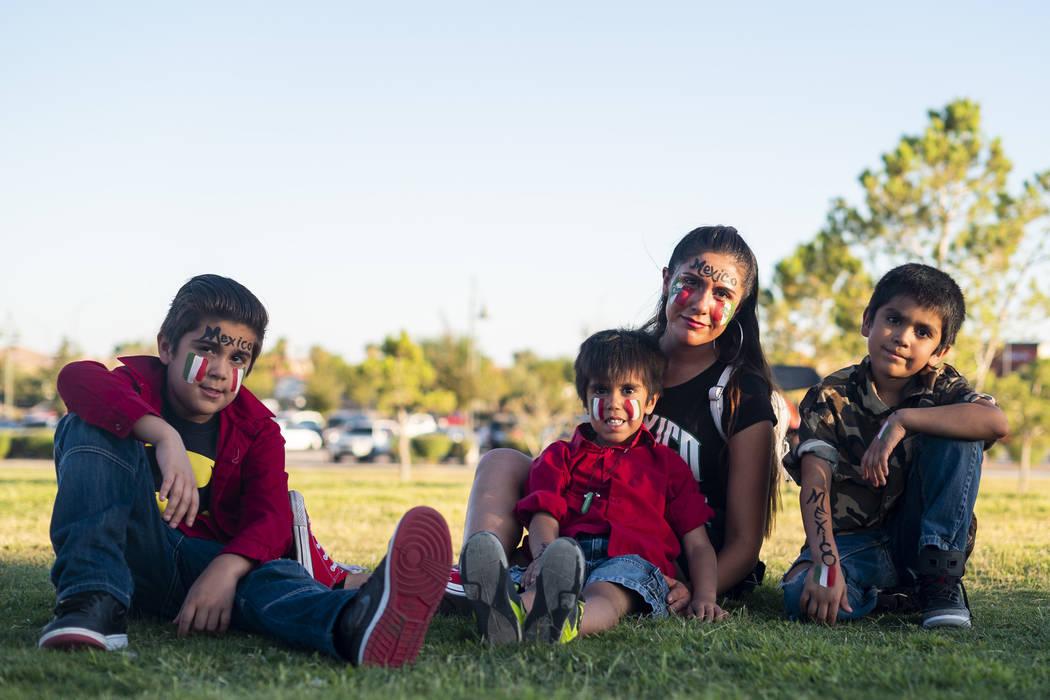 From left, Zion Garcia, 9, Angelo Garcia, 5, Marleen Salinas and Kaiden Garcia, 7, pose for a photograph at the El Tiempo Fiesta Las Vegas at Craig Ranch Regional Park in North Las Vegas, Saturday ...