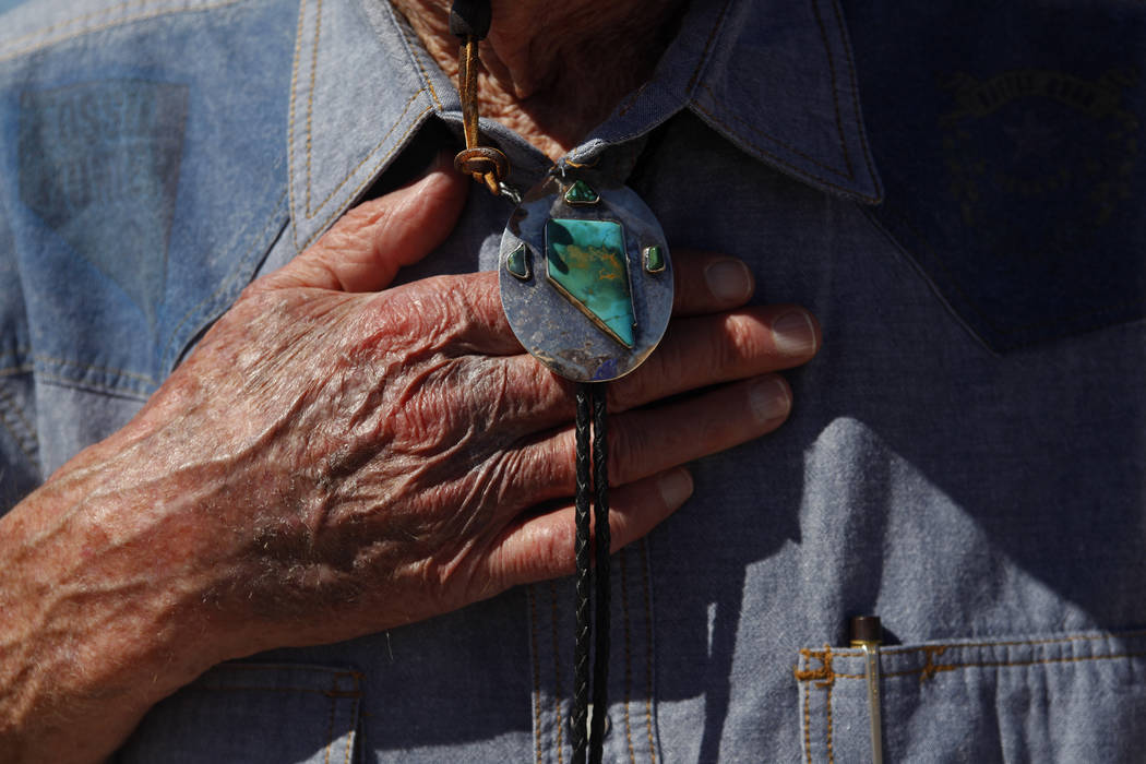 Harold Larson shows off his bolo tie at an event unveiling the new Ice Age Fossils State Park visitor center plans in Las Vegas, Thursday, Sept. 13, 2018. It's the first new state park in Southern ...