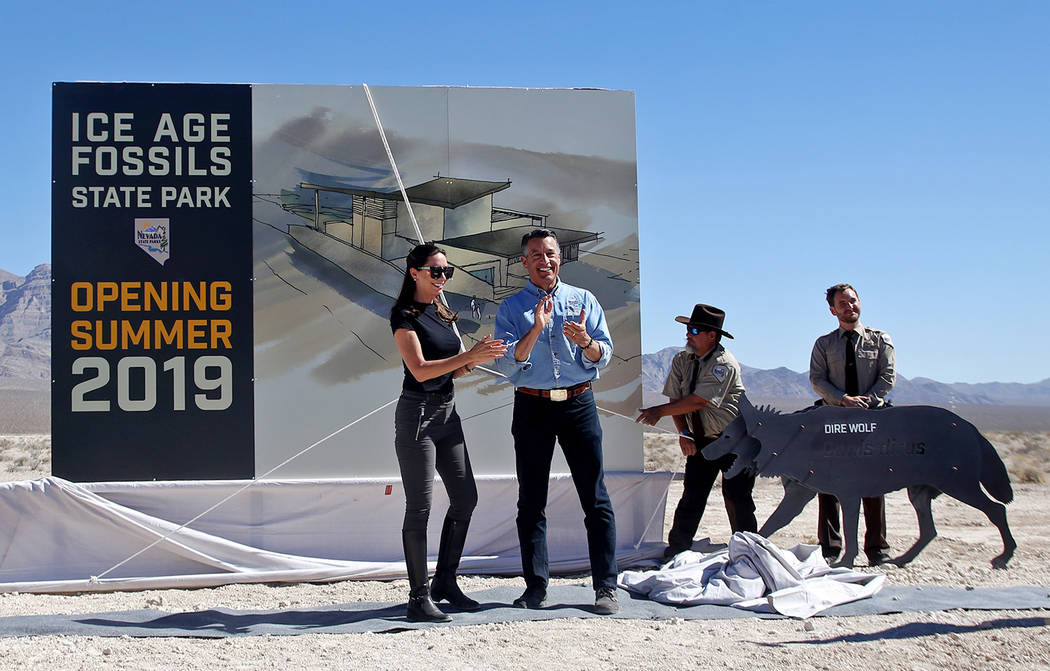 Gov. Brian Sandoval and his wife Lauralyn McCarthy unveil the visitor center plans for the new Ice Age Fossils State Park in Las Vegas, Thursday, Sept. 13, 2018. It's the first new state park in ...