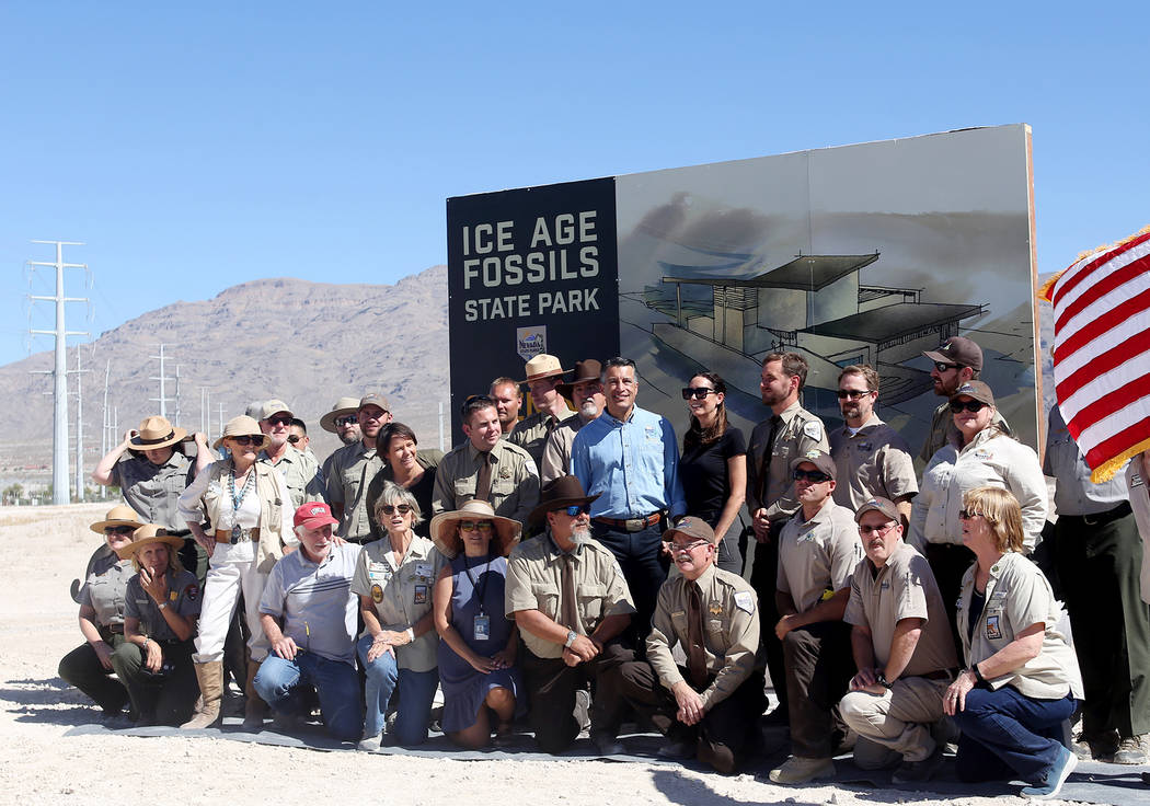Gov. Brian Sandoval poses with his wife Lauralyn McCarthy with the staff of the state and national parks and local organizations that helped create the new Ice Age Fossils State Park at an event u ...