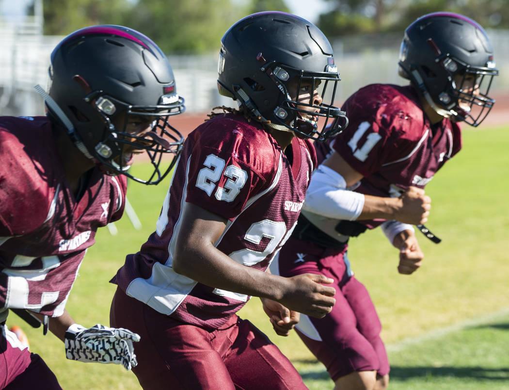 Running back Jordan Norwood, junior, center, practices at Cimarron-Memorial High School in Las Vegas, Tuesday, Sept. 11, 2018. (Marcus Villagran/Las Vegas Review-Journal) @marcusvillagran
