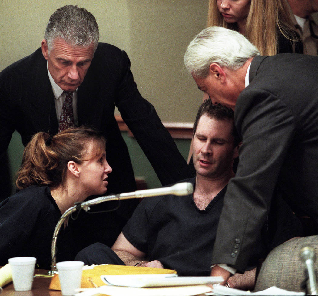 Sandy Murphy and attorneys John Momot, left, and Bill Terry console Rick Tabish during a break in the Ted Binion murder trial in 2000. (File Photo)
