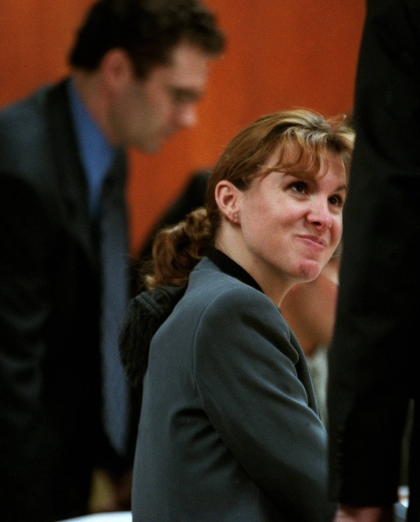 Sandy Murphy talks to her attorney John Momot while Rick Tabish stands behind her during a break in April 2000. (File Photo)