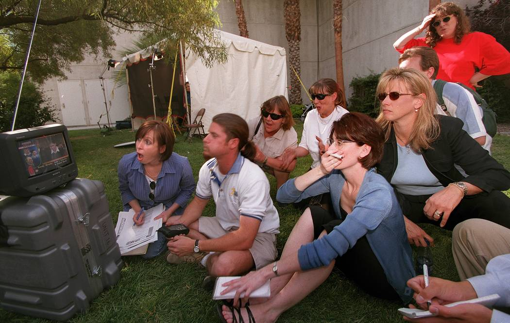 Media and court observers watch televised coverage on the courthouse lawn as the verdicts for Sandy Murphy and Rick Tabish, who were accused in the death of Ted Binion, are read in May 2000. (File ...