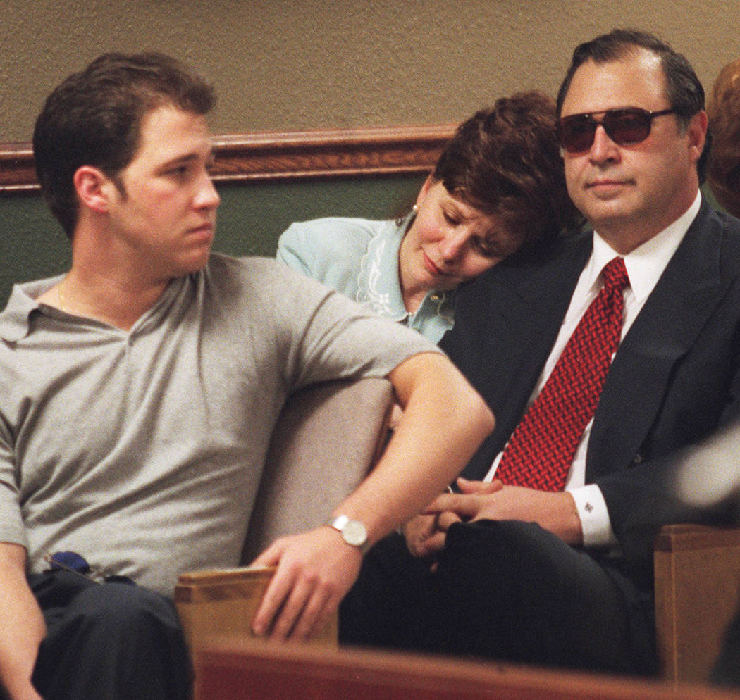 Becky Behnen rests her head on the shoulder of her husband, Nick, in May 2000 while they and their son Benny wait for the verdicts to be read in the Ted Binion murder trial. (File Photo)