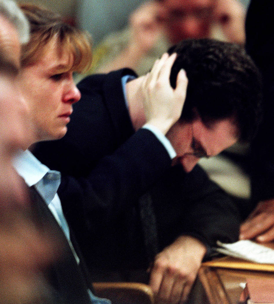 Sandy Murphy touches Rick Tabish while Tabish's mother, Lani, testifies in February 2001 during the penalty phase of the Ted Binion murder trial. (File Photo)