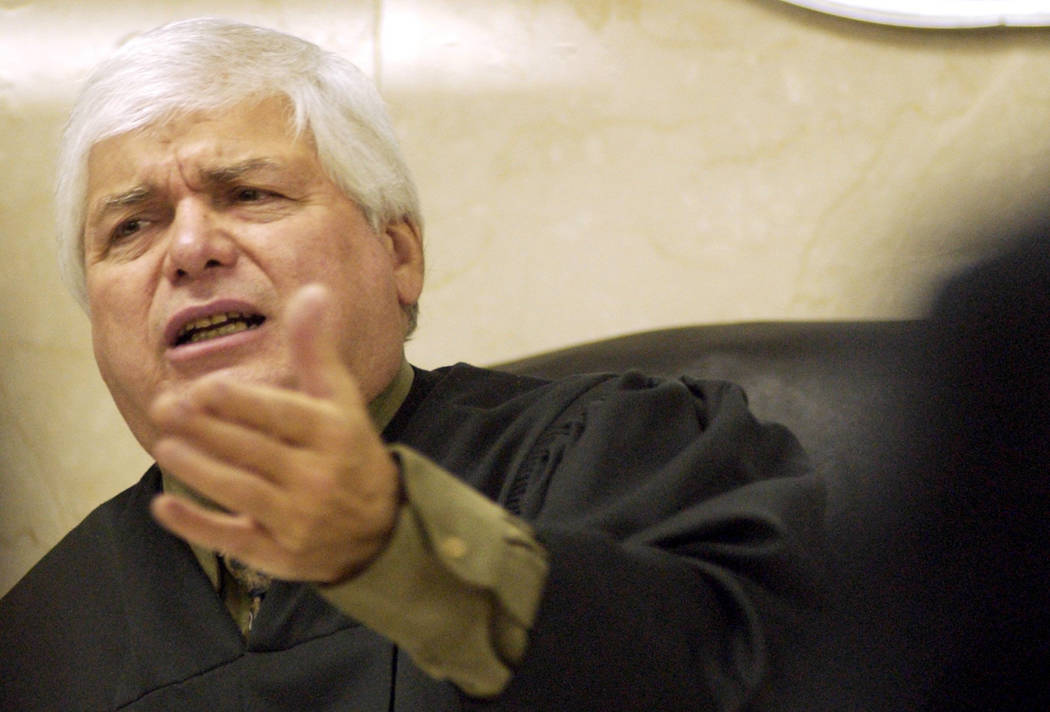 District Judge Joseph Bonaventure instructs counsel in November 2004 during a break in the Ted Binion murder trial. (File Photo)