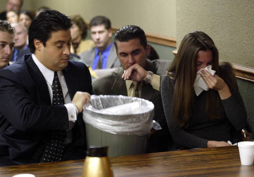 Attorney Michael Cristalli grabs a garbage can in November 2004 while a nervous Sandy Murphy gets sick before the verdicts were read at her second murder trial. Murphy was found not guilty. (File ...