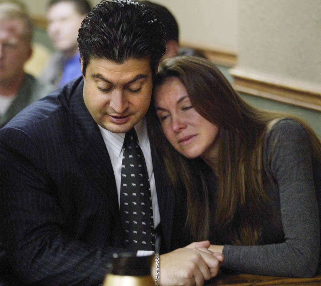 Sandy Murphy hugs attorney Michael Cristalli in November 2004 after the verdicts were read in the second murder trial related to the death of Ted Binion. Murphy was found not guilty. (File Photo)