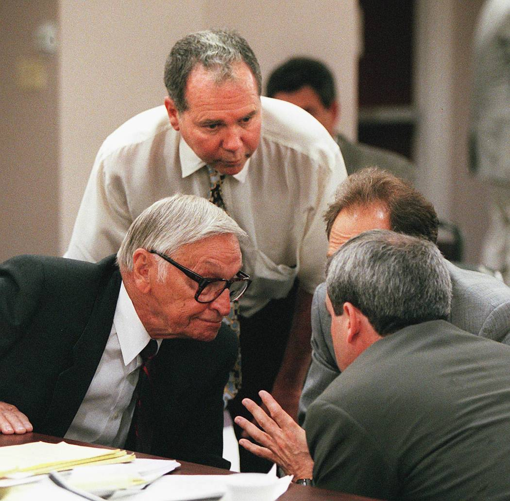 Ted Binion and his attorneys gather around to discuss strategy during a Nevada Gaming Commission hearing in April 1996. (File Photo)