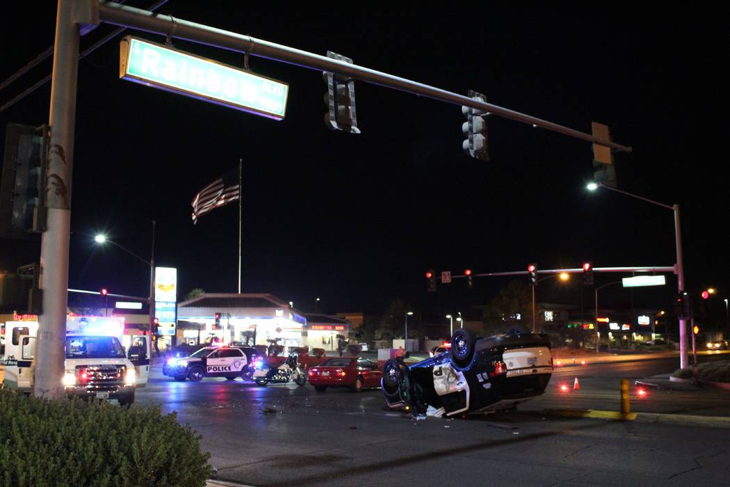 Las Vegas police investigate a crash involving a Metropolitan Police Department vehicle Thursday, Sept. 13 at the intersection of Rainbow Boulevard and Tropicana Avenue. (Max Michor/Las Vegas Revi ...