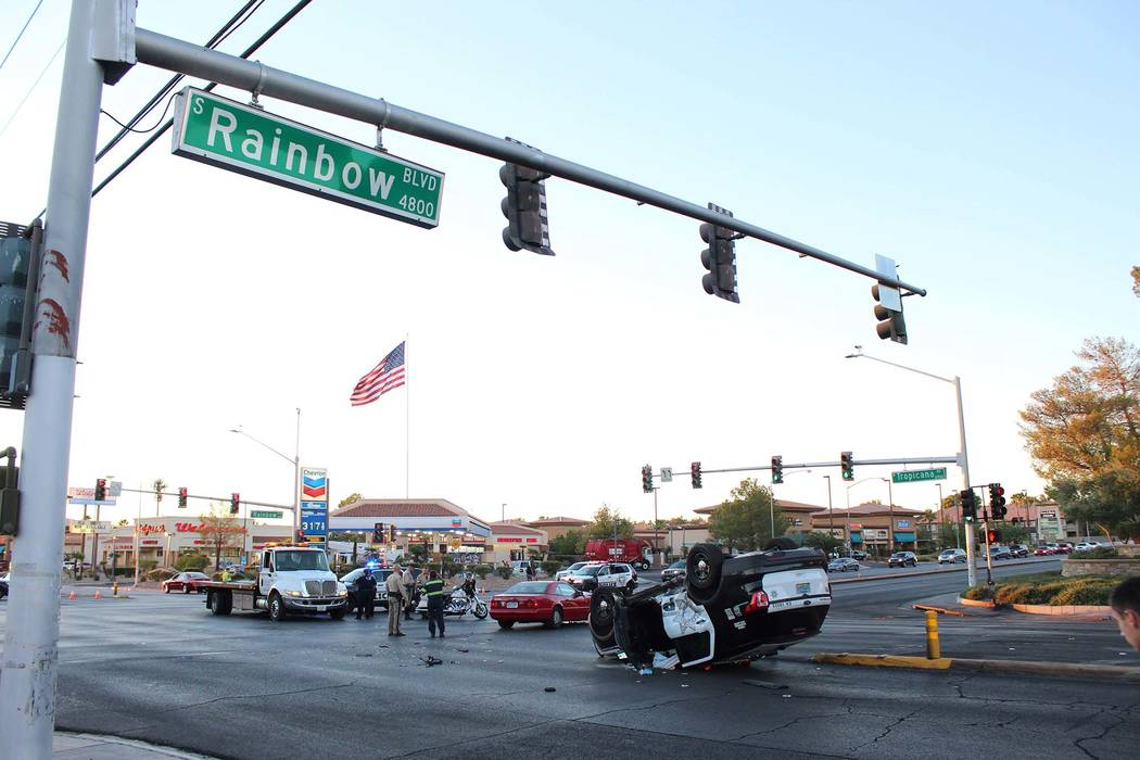 Las Vegas police investigate a crash involving a Metropolitan Police Department vehicle Thursday, Sept. 13, 2018, at the intersection of Rainbow Boulevard and Tropicana Avenue. (Max Michor/Las Veg ...