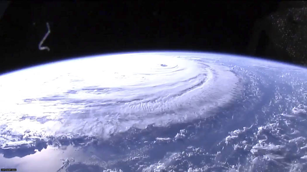 This image provided by NASA shows Hurricane Florence from the International Space Station on Wednesday, Sept. 12, 2018, as it threatens the U.S. East Coast. Hurricane Florence is coming closer and ...