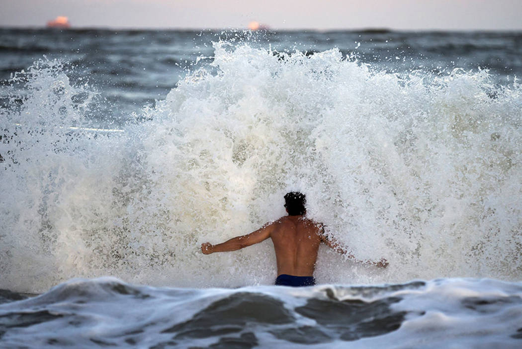 Body surfer Andrew Vanotteren, of Savannah, Ga., crashes into waves from Hurricane Florence, Wednesday, Sept., 12, 2018, on the south beach of Tybee Island, Ga. (AP Photo/Stephen B. Morton)