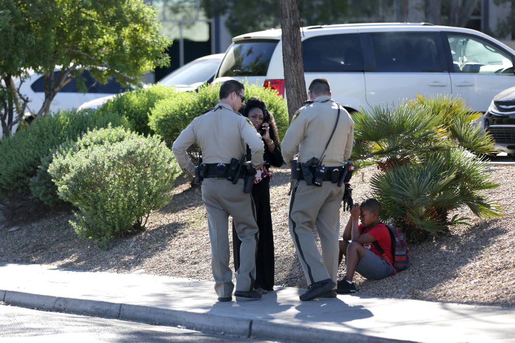 Las Vegas police investigate an incident where a child was hit by an auto when running across Lake Mead Boulevard just east of Tenaya Way on Thursday, Sept. 13, 2018. (Michael Quine/Las Vegas Revi ...