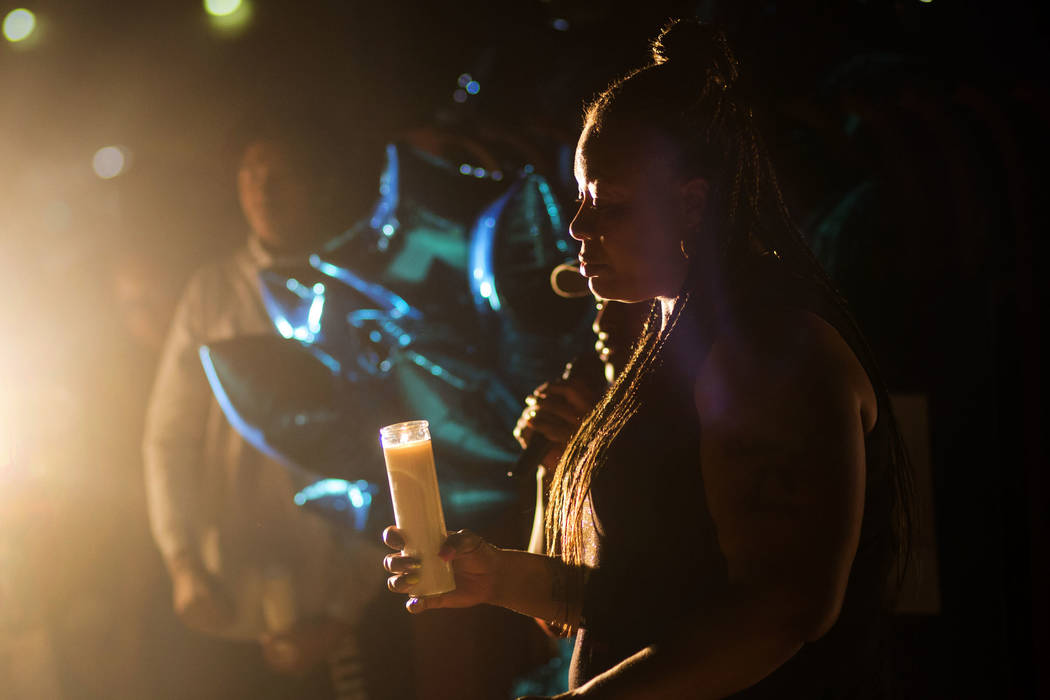 Annie Marshall holds a candle in memory of her son, Dalvin Brown, a Canyon Springs student who was shot and killed this past Tuesday, during a candlelight vigil outside of the school at Alexander ...