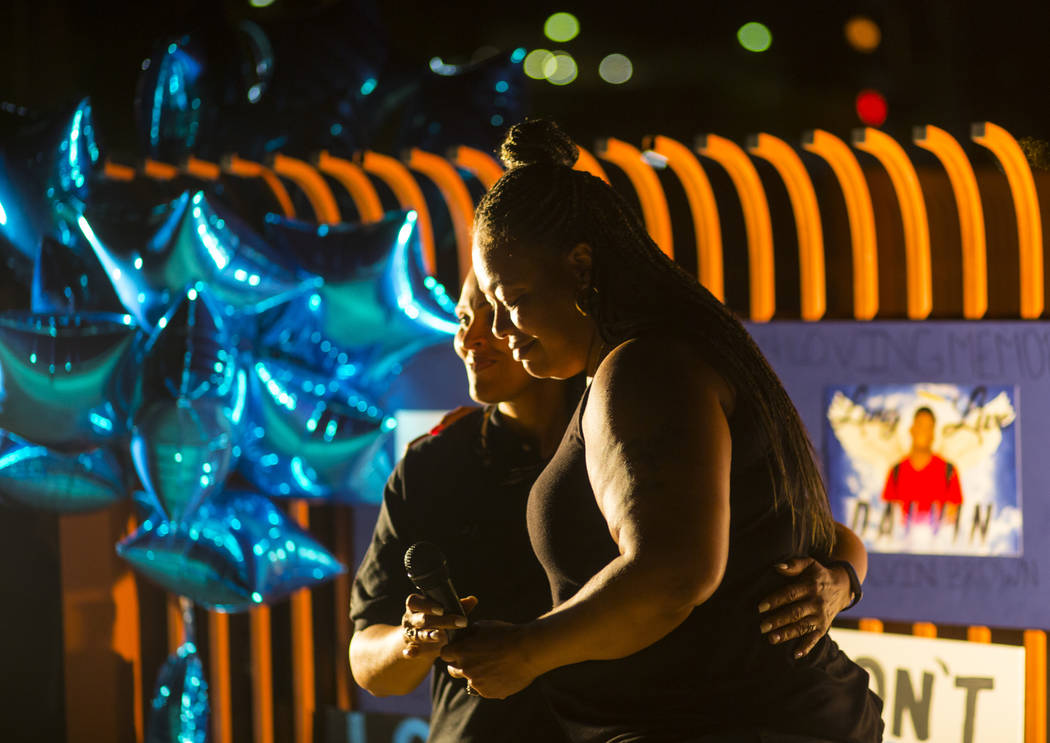 Annie Marshall, right, gets a hug from is comforted by Pastor Lola Hester during a candlelight vigil for Marshall's son Dalvin Brown, a Canyon Springs student who was shot and killed this past Tue ...