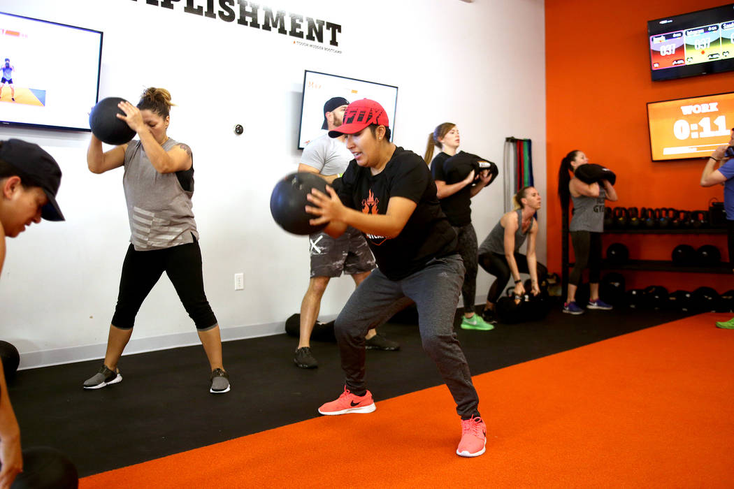 Letxy Ramirez does a ball slam at a Tough Mudder Bootcamp class in Las Vegas, Sunday, Sept. 16, 2018. Rachel Aston Las Vegas Review-Journal @rookie__rae