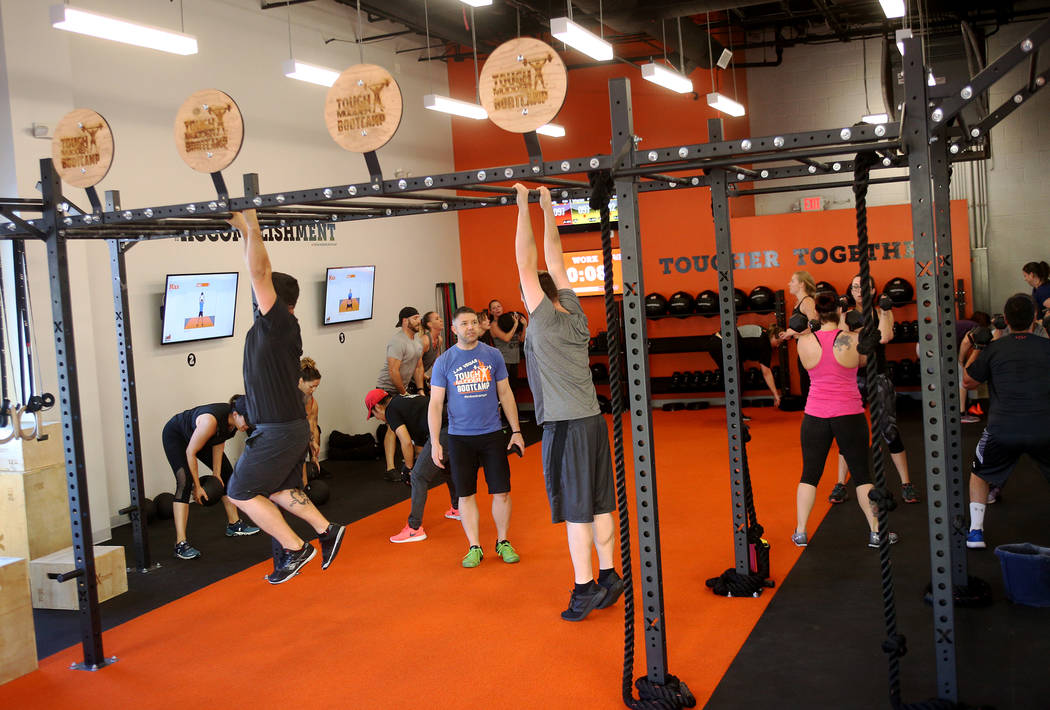 Audrey Cook, left, and Sandy Passi, right, do dumbbell squats at a Tough Mudder Bootcamp class in Las Vegas, Sunday, Sept. 16, 2018. Rachel Aston Las Vegas Review-Journal @rookie__rae