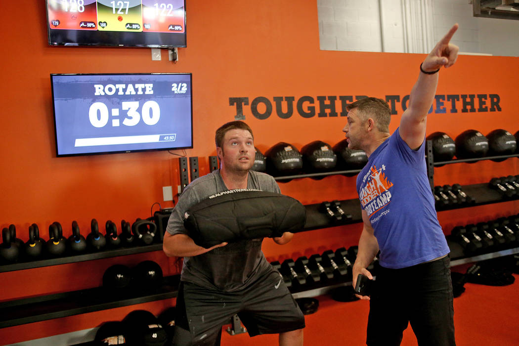Head Coach Cory Drumright instructs Eric Anderegg how to do a sandbag clean at a Tough Mudder Bootcamp class in Las Vegas, Sunday, Sept. 16, 2018. Rachel Aston Las Vegas Review-Journal @rookie__rae