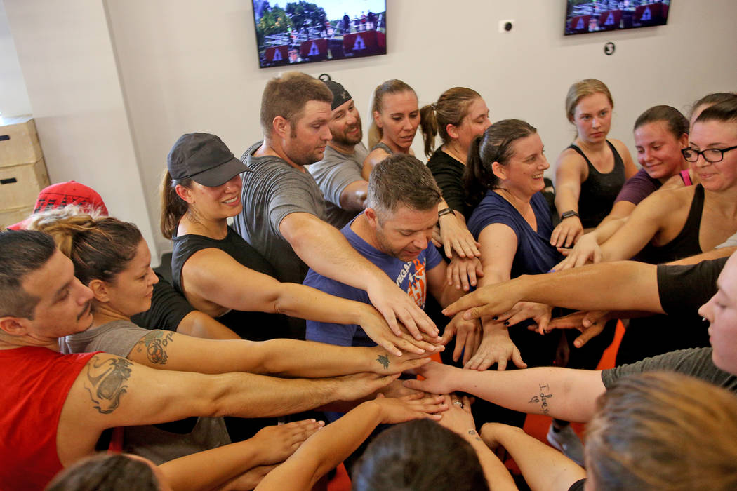 Head Coach Cory Drumright huddles with the class at a Tough Mudder Bootcamp class in Las Vegas, Sunday, Sept. 16, 2018. Rachel Aston Las Vegas Review-Journal @rookie__rae