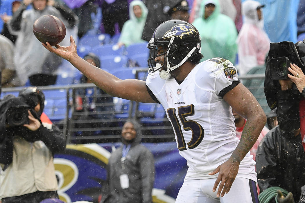 Baltimore Ravens wide receiver Michael Crabtree (15) celebrates his touchdown during the first half of an NFL football game between the Baltimore Ravens and the Buffalo Bills, Sunday, Sept. 9, 201 ...