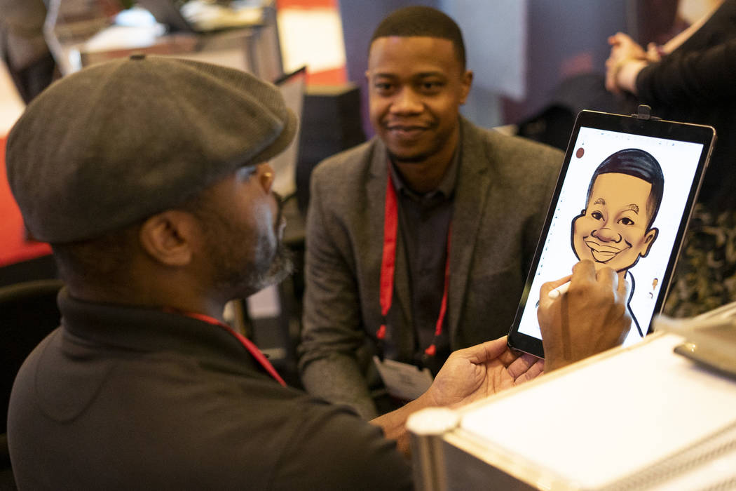 Digital caricaturist Damon Renthrope draws a caricature of FedEx ecommerce sales specialist Nate Ollie at Shop.org 2018 at Sands Expo in Las Vegas, Thursday, Sept. 13, 2018. (Marcus Villagran/Las ...
