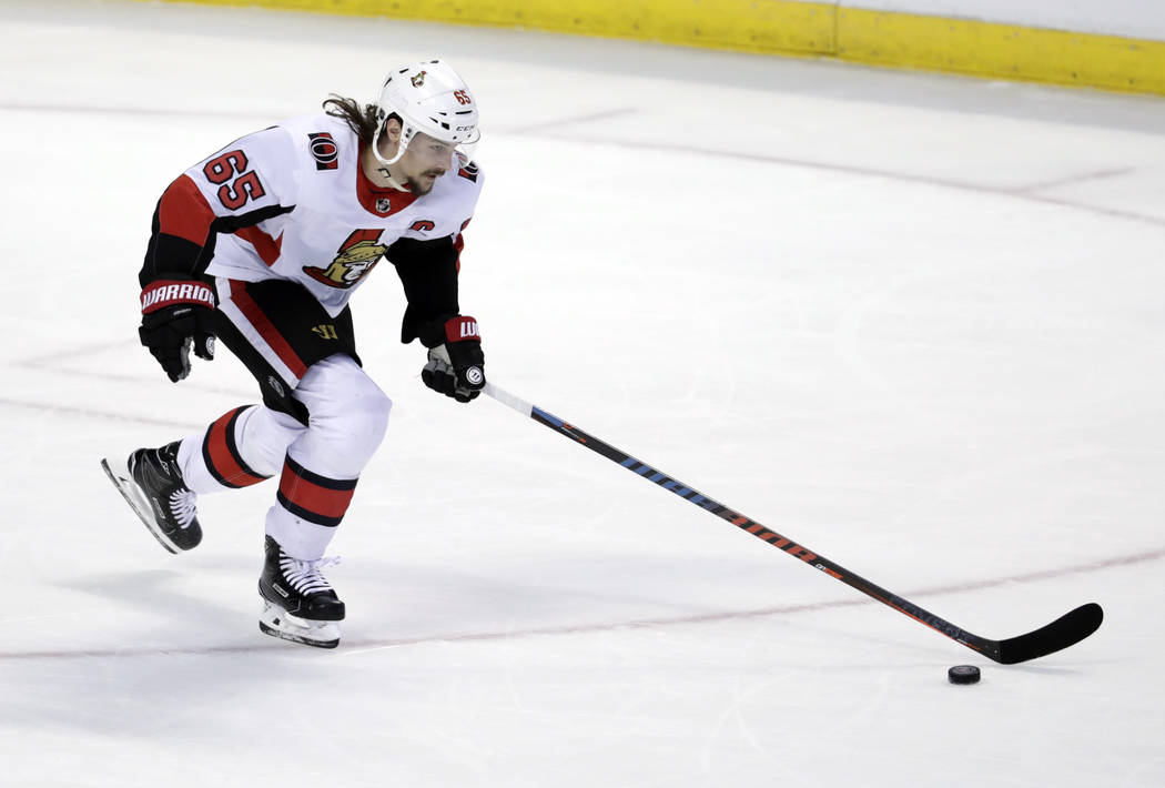 Ottawa Senators defenseman Erik Karlsson (65) skates with the puck during the third period of an NHL hockey game against the Florida Panthers, Monday, March 12, 2018, in Sunrise, Fla. The Senators ...