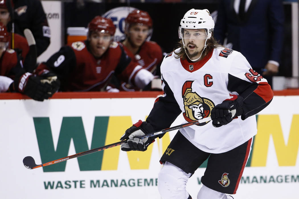 Ottawa Senators defenseman Erik Karlsson (65) skates to the puck during the first period of an NHL hockey game against the Arizona Coyotes Saturday, March 3, 2018, in Glendale, Ariz. The Coyotes d ...