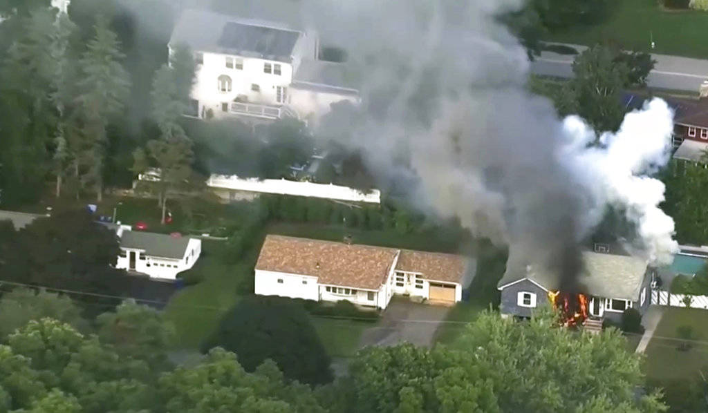 In this image take from video provided by WCVB in Boston, flames rise from a house in Lawrence, Mass, a suburb of Boston, Thursday, Sept. 13, 2018. Emergency crews are responding to what they beli ...