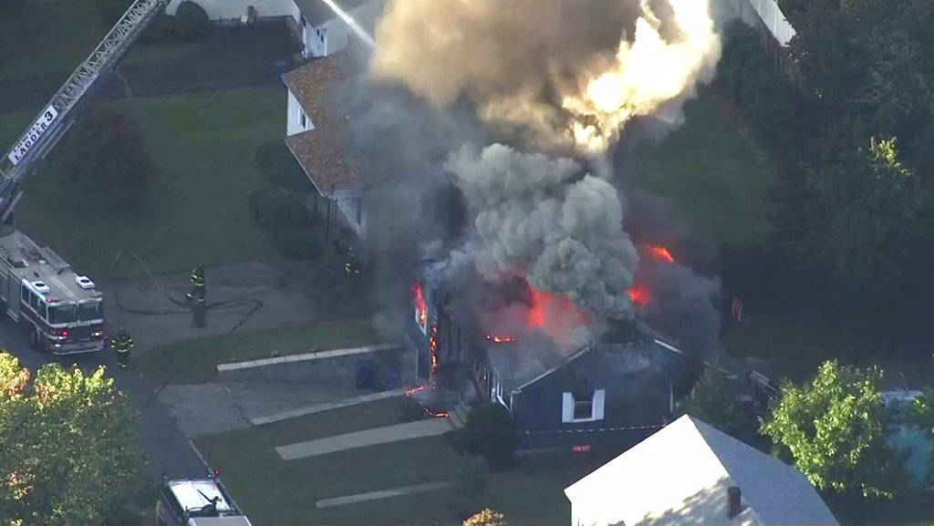 In this image take from video provided by WCVB in Boston, firefighters battle a raging house fire in Lawrence, Mass, a suburb of Boston, Thursday, Sept. 13, 2018. Emergency crews are responding to ...