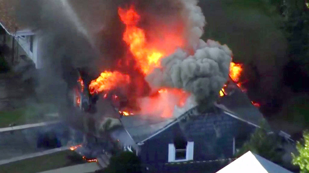 In this image take from video provided by WCVB in Boston, flames consume a home in Lawrence, Mass, a suburb of Boston, Thursday, Sept. 13, 2018. Emergency crews are responding to what they believe ...