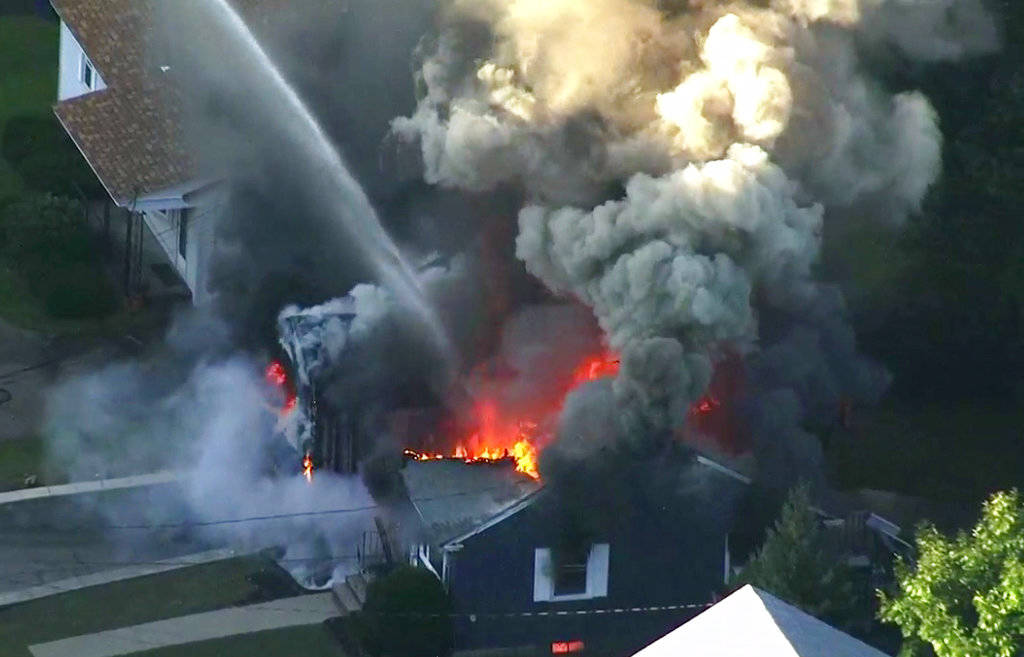 In this image take from video provided by WCVB in Boston, flames consume the roof of a home in Lawrence, Mass, a suburb of Boston, Thursday, Sept. 13, 2018. Emergency crews are responding to what ...