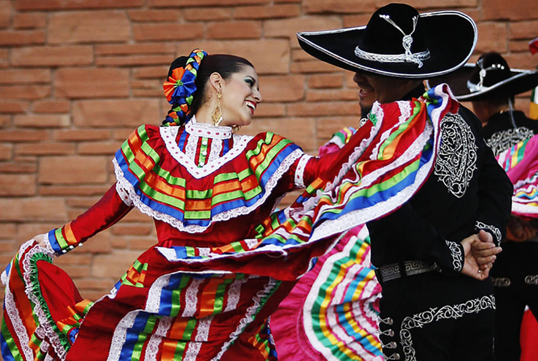 Melissa Manriquez, left, dances a traditional Mexican dance with her partner Ulises Espitia at the Clark County Government Center Amphitheater in Las Vegas in 2011. (Las Vegas Review-Journal)