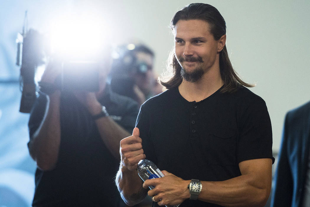 Erik Karlsson arrives to talk to media on the Ottawa Senators first day of NHL hockey training camp in Ottawa on Thursday, Sept. 13, 2018, after he was traded by the team to the San Jose Sharks. ( ...
