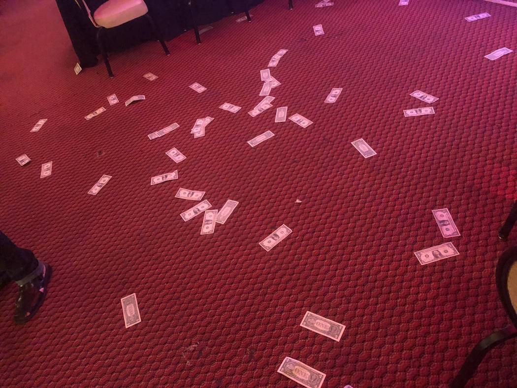 "Cash -- real cash -- is shown on the floor at the Plaza Showroom as part of a scene in ""A Mob Story"" on Thursday, Sept. 13, 2018. (John Katsilometes/Las Vegas Review-Journal)"