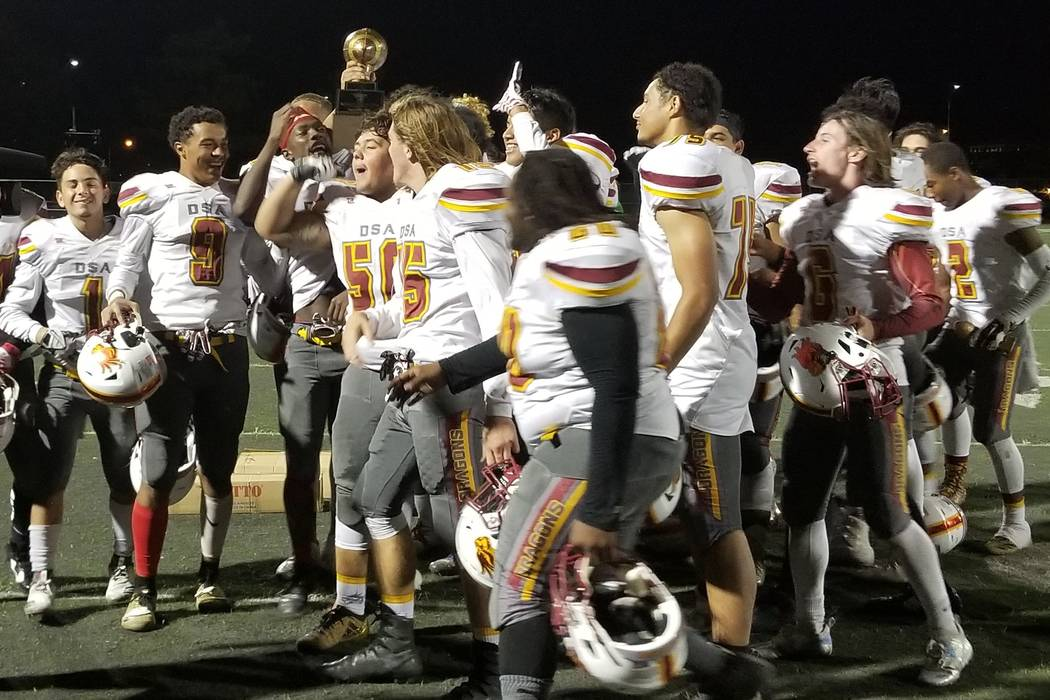 Del Sol players celebrate their 48-0 road win over Rancho on Thursday, Sept. 13, 2018. (Damon Seiters/Las Vegas Review-Journal)