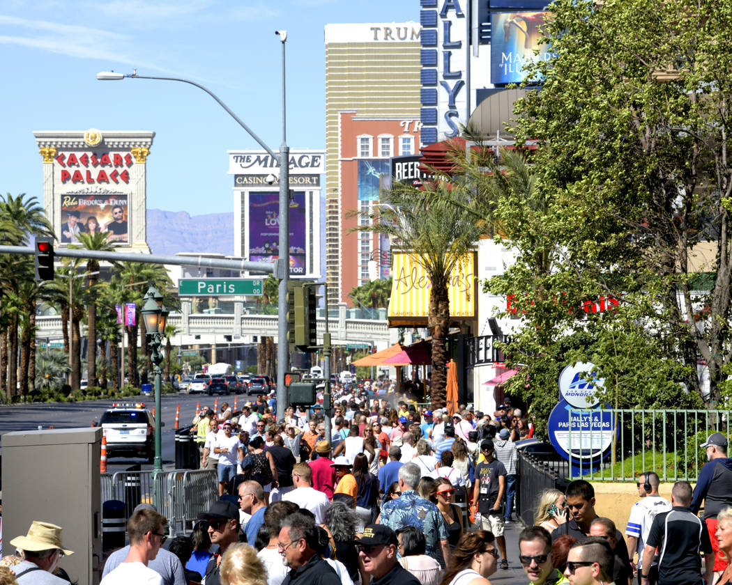 NASCAR fans Jam the walkways to get a glimpse of their favorite NASCAR drivers as they jump in their cars and parade down the Las Vegas Strip. Thursday, September 13, 2018. CREDIT: Glenn Pinkerto ...