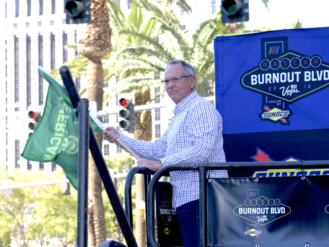 Clark County Commissioner Jim Gibson gives NASCAR drivers the green flag to parade down the Las Vegas Strip. Thursday, September 13, 2018. CREDIT: Glenn Pinkerton/Las Vegas News Bureau