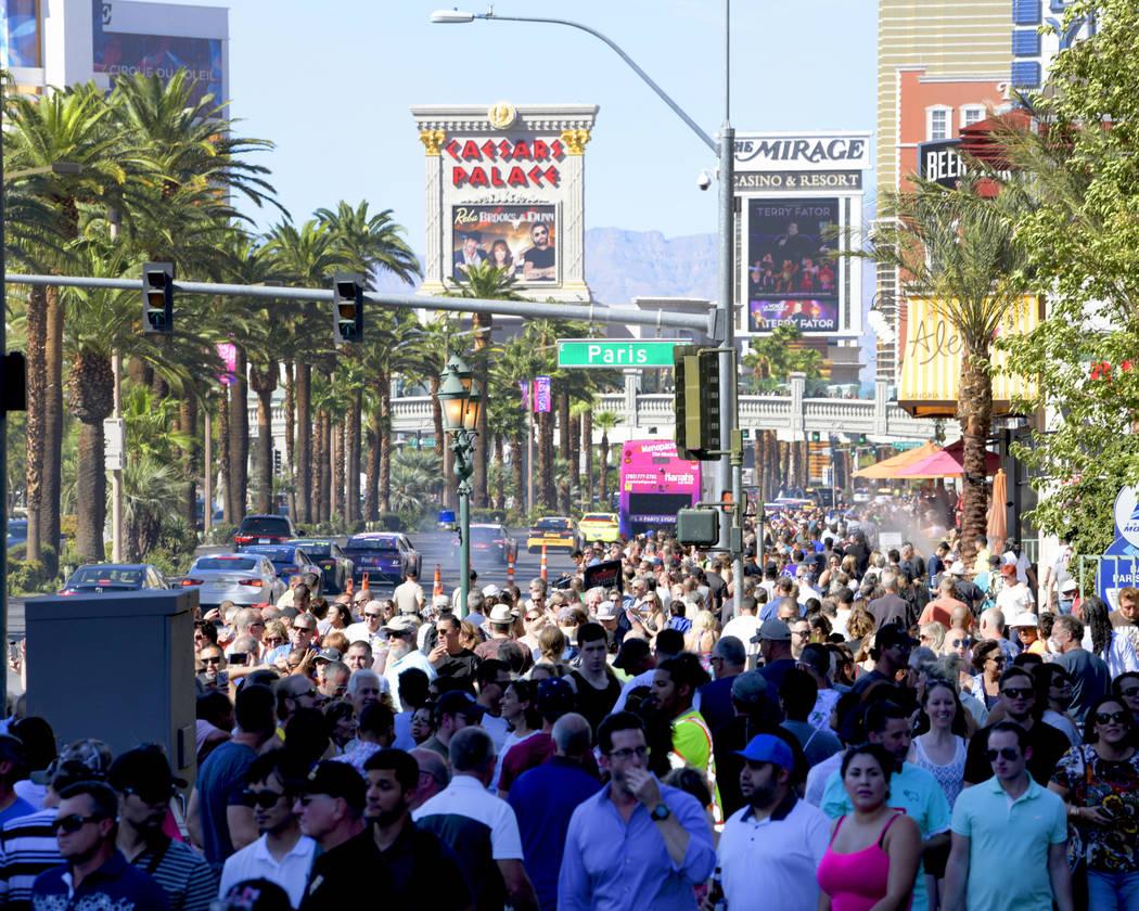 Fans cheer as NASCAR drivers Òlay rubberÓ and parade down the Las Vegas Strip. Thursday, September 13, 2018. CREDIT: Glenn Pinkerton/Las Vegas News Bureau