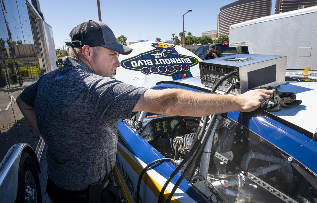Louie Ellis of Gaunt Racing checks the timing of the NBCSN leader car for the 2018 NASCAR Burnout Blvd introducing the NASCAR South Point 400 Weekend as cars are staged in the Las Vegas Convention ...